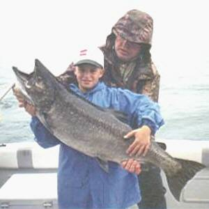 Pictured here is 14 year old Bobby Moore of Sayre, P.A. with a thirty four pound King Salmon caught from Lake Ontario. This fantastic salmon was  caught in late July 2003 fishing with Dave Johnson of  Silver Bear Sports