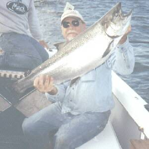 Greg Komenko is pictured here with a nice 25 pound king salmon taken in early August 2004.