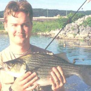 gordon bennett with a hybrid striped bass
