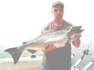 Joseph Pawelko Jr was fishing with Captain J Mickey Mc Donald of Irondequoit Bay Charters Rochester, New York. Thats where he caught this 28 pound king. The big salmon hit a Wonderbread Stinger