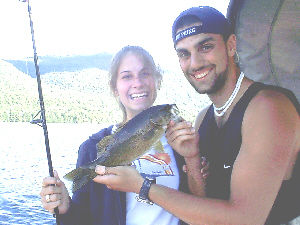 Pictured here is Allison Wagner and Brian Brodman of Queens, NY. Brian is holding a feisty smallmouth bass that was caught from Lake George in August 2003. The smallmouth bass was caught with a minnow while fishing from a boat