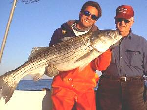 Mike the mate on the Windy with a 30 pound striped bass