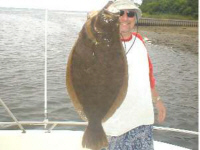 James Tully with an 8 pound 12 ounce fluke from Shinnecock Inlet