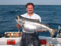 Craig Rice of Canton, Ohio caught this 38 pound King Salmon from Lake Ontario in July 15, 2002