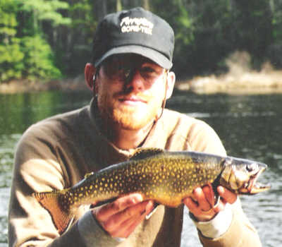 Mike Crawford of Upstate Guide Service with a fantastic Brook Trout caught on a big streamer in early spring from the Central Adirondacks